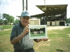 Published: No Published Caption Original: Published: Lee Gliarmis stands, holding a rendering of the museum, where the museum will be constructed next to Fleming Stadium.	            (Photo by Laura Keeter) Original: No Original Caption